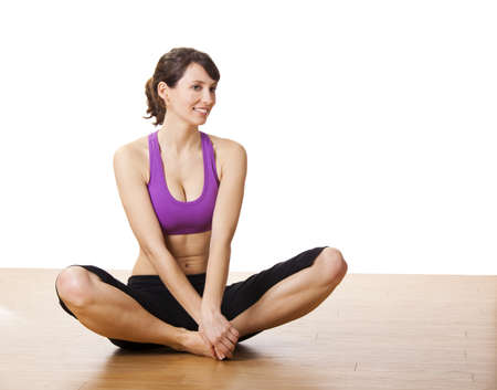 Beautiful and athletic young woman doing yoga exercises Stock Photo - 17221820