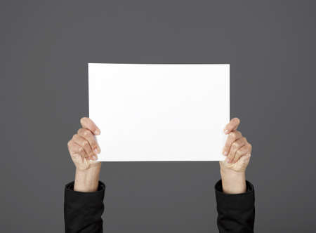 Woman holding a blank paper sheet with both hands Stock Photo - 17221825