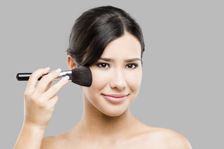 Beauty portrait of an Asian young woman applying makeup Stock Photo - 17903531