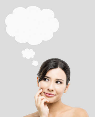 Beautiful Asian woman thinking with  a thought ballon over her head Stock Photo - 17903504
