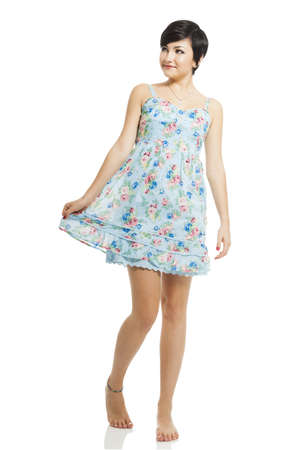 Beautiful teenager with a blue dress dancing and jumping, isolated over white background Stock Photo - 17903502