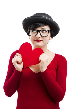 Beautiful and funny nerd girl, holding a paper heart isolated on white background photo