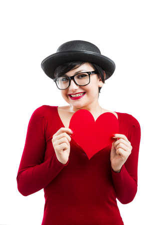 Beautiful and funny nerd girl, holding a paper heart isolated on white background Stock Photo - 17903525