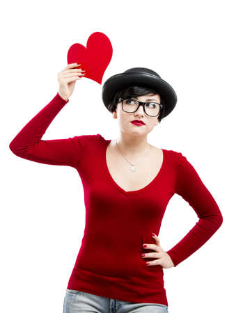 Beautiful  and funny nerd girl, holding a heart over her head, aganist a white background Stock Photo - 17903508