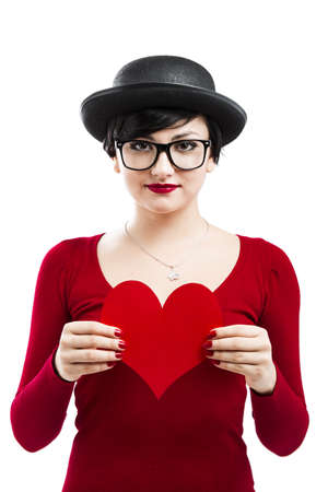 Beautiful and funny nerd girl, holding a paper heart isolated on white background Stock Photo - 17903527