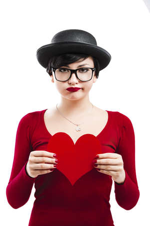 Beautiful and funny nerd girl, holding a paper heart isolated on white background Stock Photo - 17903522