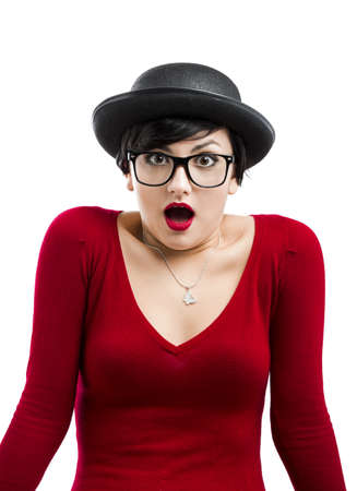 Beautiful girl with a astonished expression, wearing a hat and nerd glasses, isolated on white Stock Photo - 17903533