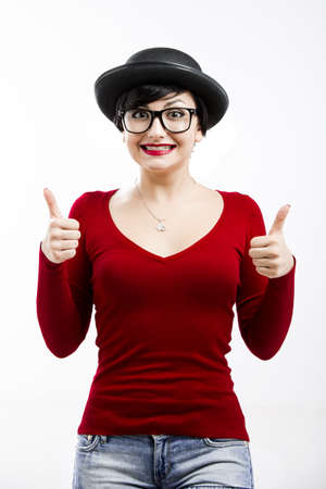 Beautiful girl wearing a hat and nerd glasses and thumbs up, isolated on white Stock Photo - 17903532