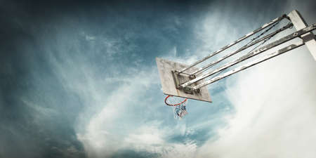 Outdoor Basketball basket against a blue sky Stock Photo - 18298223