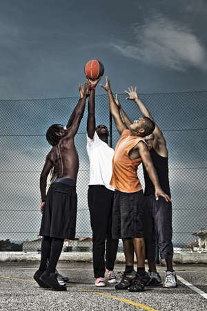 boy basketball: Group portrait of a street basketball team Stock Photo