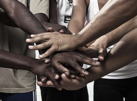 Closeup portrait of group with mixed race people with hands together photo