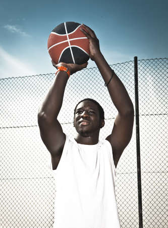 Portrait of a afroamerican man playing basketball in outdoor Stock Photo - 18293928