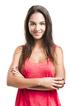 Beautiful young woman with arms crossed over a white background Stock Photo - 18293923