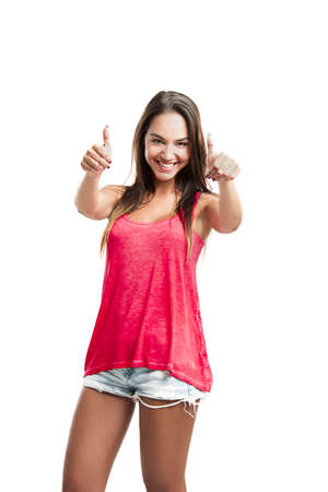 Young woman with thumbs up, isolated over a white background Stock Photo - 18293900