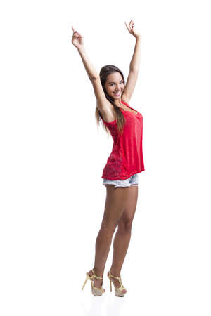 Beautiful young woman standing with arms open, isolated over a white background Stock Photo - 18293886