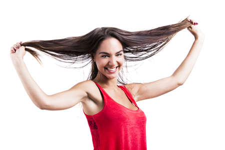 Beautiful young woman grabbing her own hair, isolated over white backgrund Stock Photo - 18293919