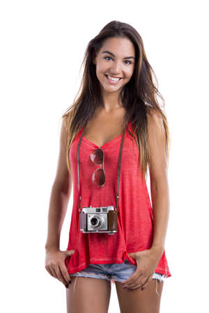 Beautiful young woman smiling and posing with a old vintage camera, isolated on white background Stock Photo - 18293922