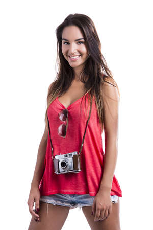 Beautiful young woman smiling and posing with a old vintage camera, isolated on white background Stock Photo - 18293924