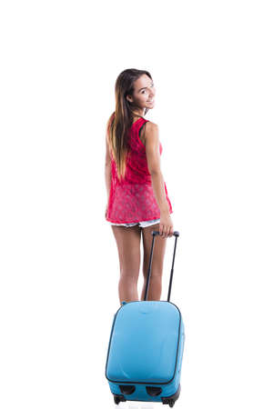 Happy woman going on vacation and walking with a suitcase Stock Photo - 18293892