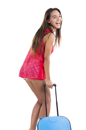Happy beautiful woman laughing and going on vacation with a suitcase Stock Photo - 18293901