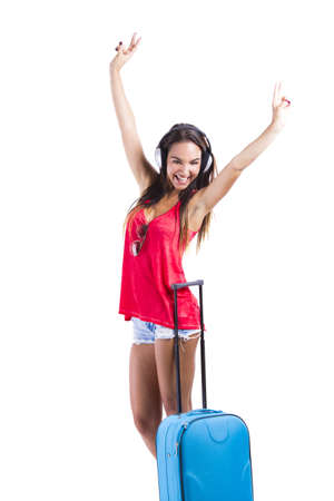 Happy woman going on vacation with a her suitcase Stock Photo - 18293889