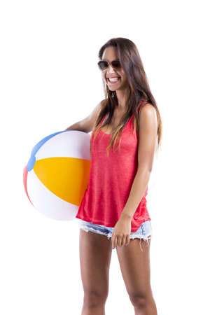 Happy beautiful woman whit sunglasses and holding a beach ball, isolated over white a background Stock Photo - 18293908
