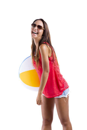 Happy beautiful woman whit sunglasses and holding a beach ball, isolated over white a background Stock Photo - 18293906