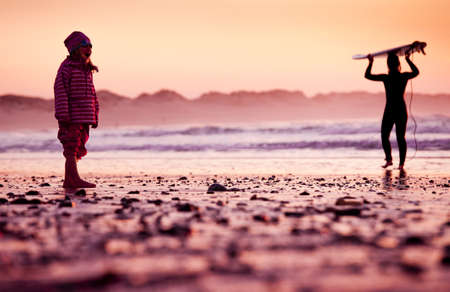 Little girl standing in the beach looking to the ocean Stock Photo - 18293927