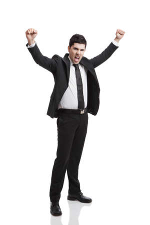 Young businessman with arms up isolated over a white background  photo