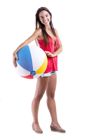 beach ball girl: Happy beautiful woman holding a beach ball, isolated over white a background