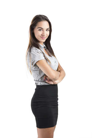 sexy business woman: Beautiful and attractive business woman with arms folded, isolated on white background Stock Photo