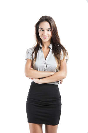 Beautiful and attractive business woman with arms folded, isolated on white background photo