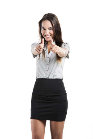 Beautiful business woman with thumbs up, isolated on white background photo