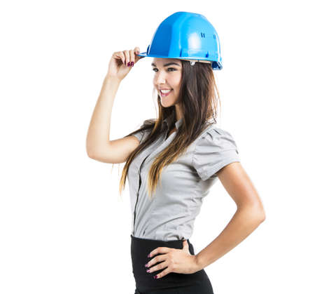 Beautiful and confident young female architect wearing a blue helmet, isolated on white background photo