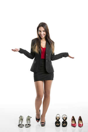 sexy businesswoman: Beautiful and attractive woman with a shoes addiction, isolated over white background