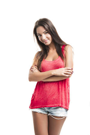 Beautiful young woman with arms crossed over a white background photo
