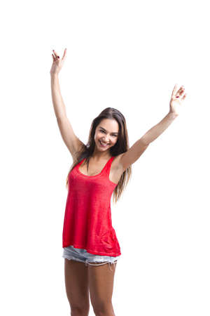 winning woman: Beautiful young woman standing with arms open, isolated over a white background Stock Photo
