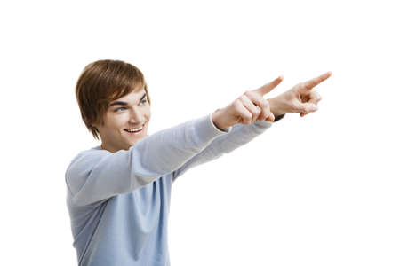 Portrait of a handsome young man pointing, isolated over a white background Stock Photo - 18971860