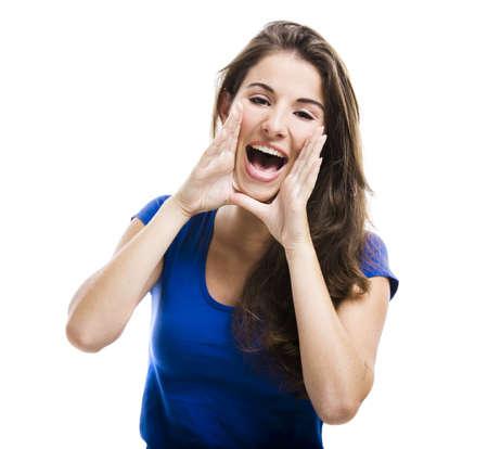 gente comunicandose: Joven y bella mujer gritando, aislados en un fondo blanco Foto de archivo