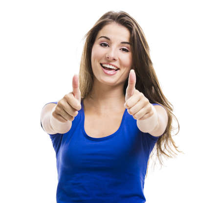 Young woman with thumbs up, isolated over a white background Stock Photo - 18971842