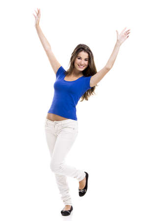 arms raised girl: Beautiful young woman standing with her arms open, isolated over a white background