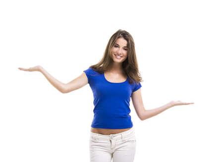 comparison: Beautiful young woman with arms open making a scale, isolated over a white background