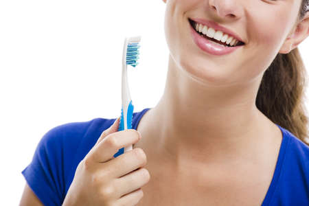 Beautiful woman with a great smile holding toothbrush, isolated over a white background Stock Photo - 18971881