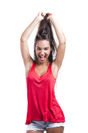 Beautiful young woman grabbing her own hair, isolated over white backgrund Stock Photo - 18971880