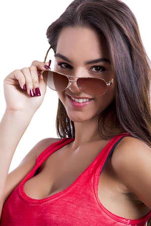 Beautiful woman wearing sunglasses over a white background Stock Photo - 18971909
