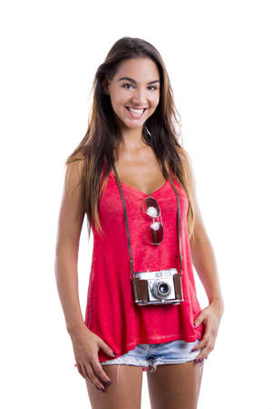 Beautiful young woman smiling and posing with a old vintage camera, isolated on white background Stock Photo - 18971879