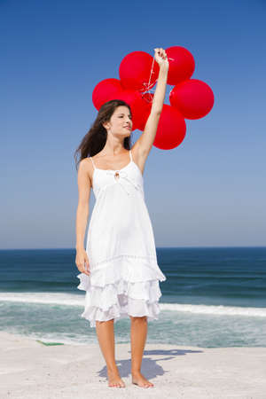 Beautiful girl with red ballons in the beach Stock Photo - 18971897