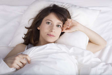 Porttrait of a beautiful and natural young girl on the bed Stock Photo - 19428425