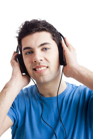 Casual young man listening music with headphones, isolated on white background Stock Photo - 19428349