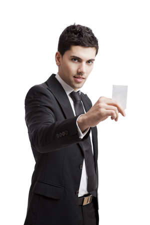 Young businessman holding a personal card on the hand, isolated over a white background Stock Photo - 19428414